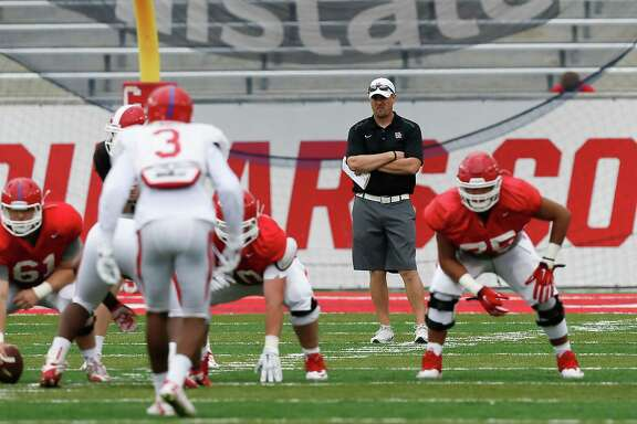 Houston Cougars head coach Tom Herman looks on during the Houston Cougars Red and White game, Saturday, April 16, 2016, in Houston. (Bob Levey/ For The Houston Chronicle)