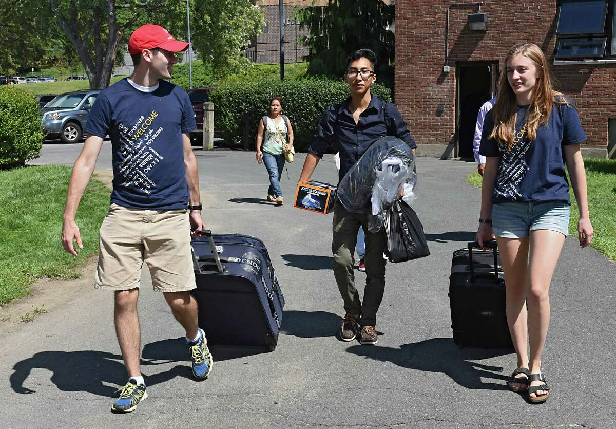 From left, junior Drew Lindholm of Belchertown, M.A., freshman Jason Arevalo of New York City and sophomore Laura Christie of New Jersey bring their belongings to their dorm at Rensselaer Polytechnic Institute on Tuesday, Aug. 23, 2016 in Troy, N.Y. (Lori Van Buren / Times Union)