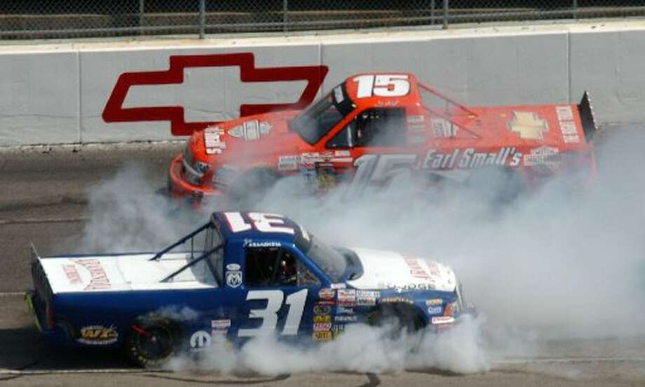 Joe Aramendia (31) spins out as Shane Hmiel (15) drives by during the NASCAR truck series Kroger 250 race at Martinsville Speedway in Martinsville, Va., April 17, 2004. Photo: Steve Helber / AP Photo