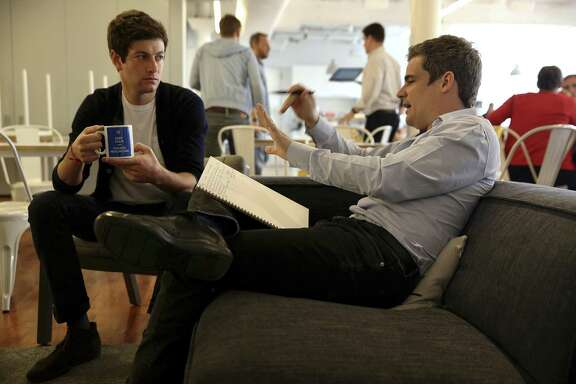 Oscar Health founders Joshua Kushner (left) and Mario Schlosser meet at the startup health insurer's offices earlier this year. Oscar, which pitches itself as a tech-savvy alternative to traditional health insurers, plans to end sales of Affordable Care Act plans in Dallas, a market it entered this year, and New Jersey. It will remain in the Los Angeles and New York City areas, as well as in San Antonio.