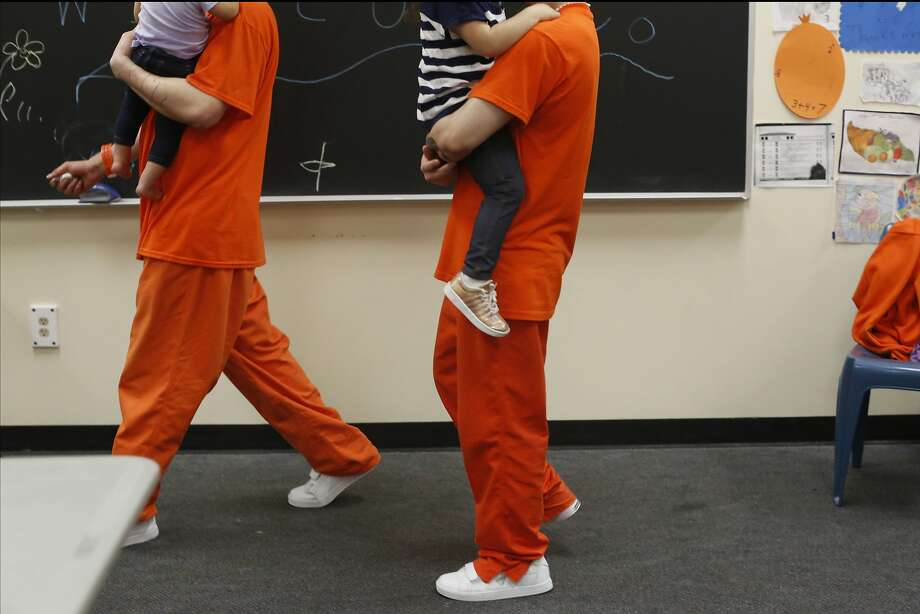 Inmates at County Jail #5 carry their children as they visit with them  during a Community Works One Family visit on Saturday, June 4, 2016 in San Francisco, California. Photo: Lea Suzuki, The Chronicle