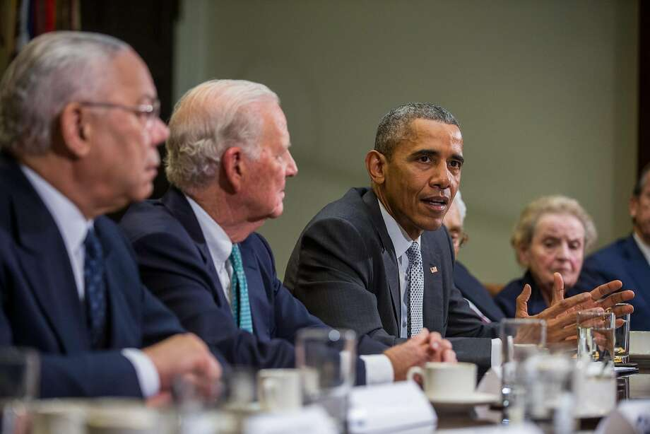 FILE -- President Barack Obama discusses the Trans-Pacific Partnership with diplomats at The White house in Washington, Nov. 13, 2015. As both presidential candidates campaign against it, the White House is negotiating with Republicans in Congress to ratify the Trans-Pacific Partnership, the largest regional trade agreement ever. From left: former Secretaries of State Colin Powell, James Baker, Obama and Madeleine Albright. (Zach Gibson/The New York Times) Photo: ZACH GIBSON, NYT
