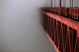 A streamlined fog bank hides the south end of the Golden Gate Bridge on May 8, 2012 in San Francisco, Calif.