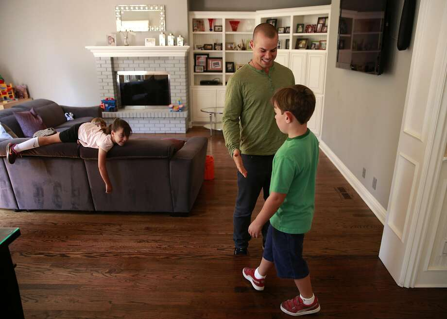 Jake Smolinski with the children of his agent Josh, 6 and Lily, 6 (left) at their Danville, California, home on Tues. Aug. 23, 2016. Oakland Athletics outfielder Jake Smolinski lives with the family of his agent Matt Sosnick, his wife Erica and their three young children Josh, Lily and Liam. Photo: Michael Macor, The Chronicle