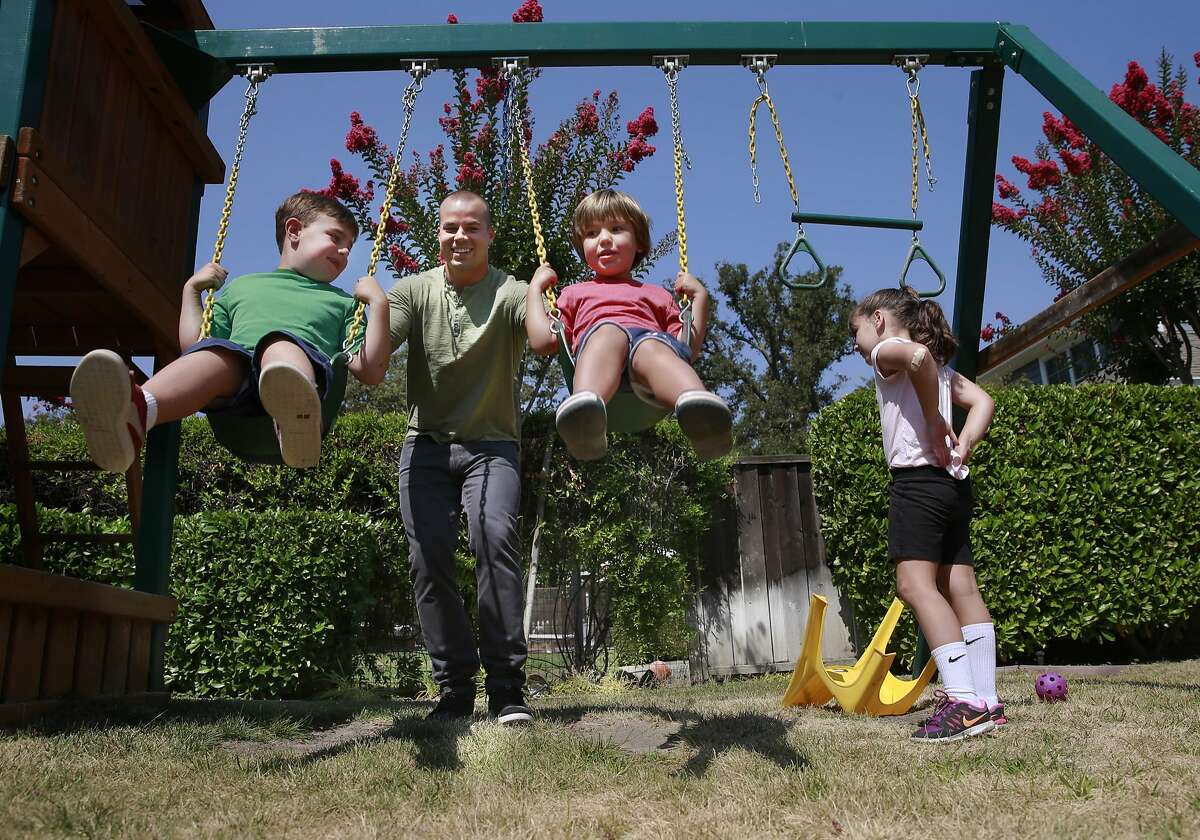 Jake Smolinski play with the children of his agent Josh, 6 Liam, 3 and Lily, 3 at their Danville, California, home on Tues. Aug. 23, 2016. Oakland Athletics outfielder Jake Smolinski lives with the family of his agent Matt Sosnick, his wife Erica and their three young children Josh, Lily and Liam.