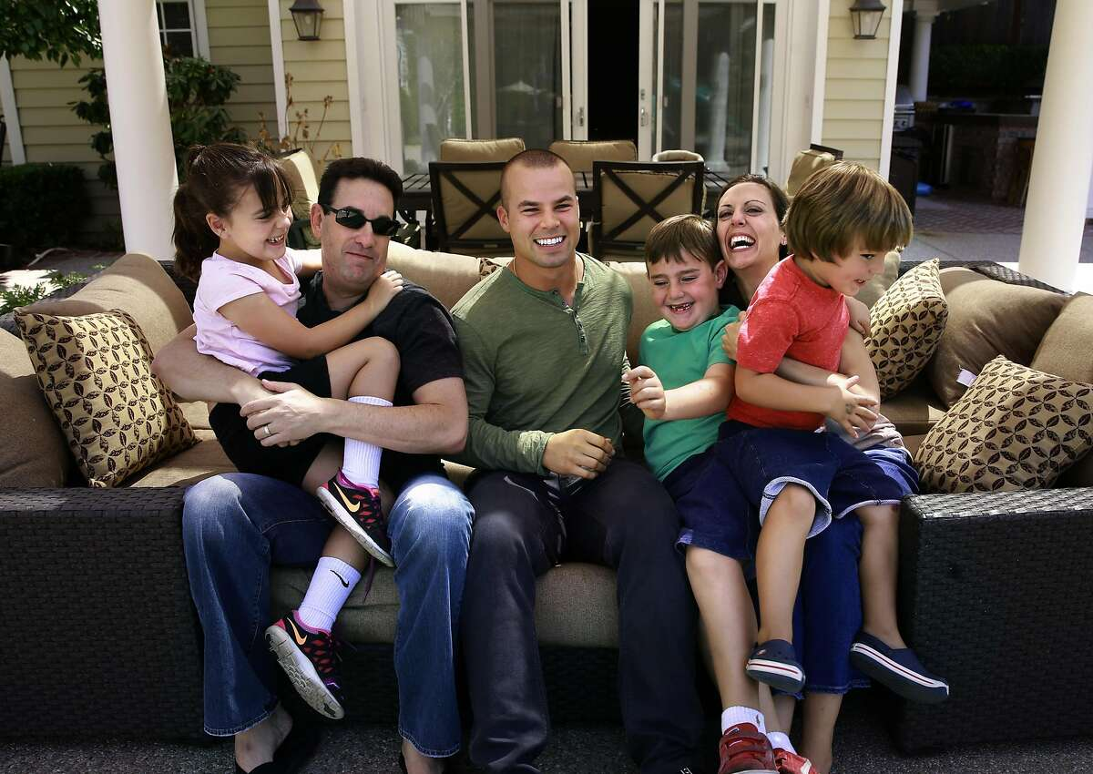 Matt and Erica Sosnick and their children Lily,6 Josh,6 and Liam,3 with Jake Smolinski, (center) at their Danville, California home, on Tues. Aug. 23, 2016. Oakland Athletics outfielder Jake Smolinski lives with the family of his agent Matt Sosnick, his wife Erica and their three young children Josh, Lily and Liam.