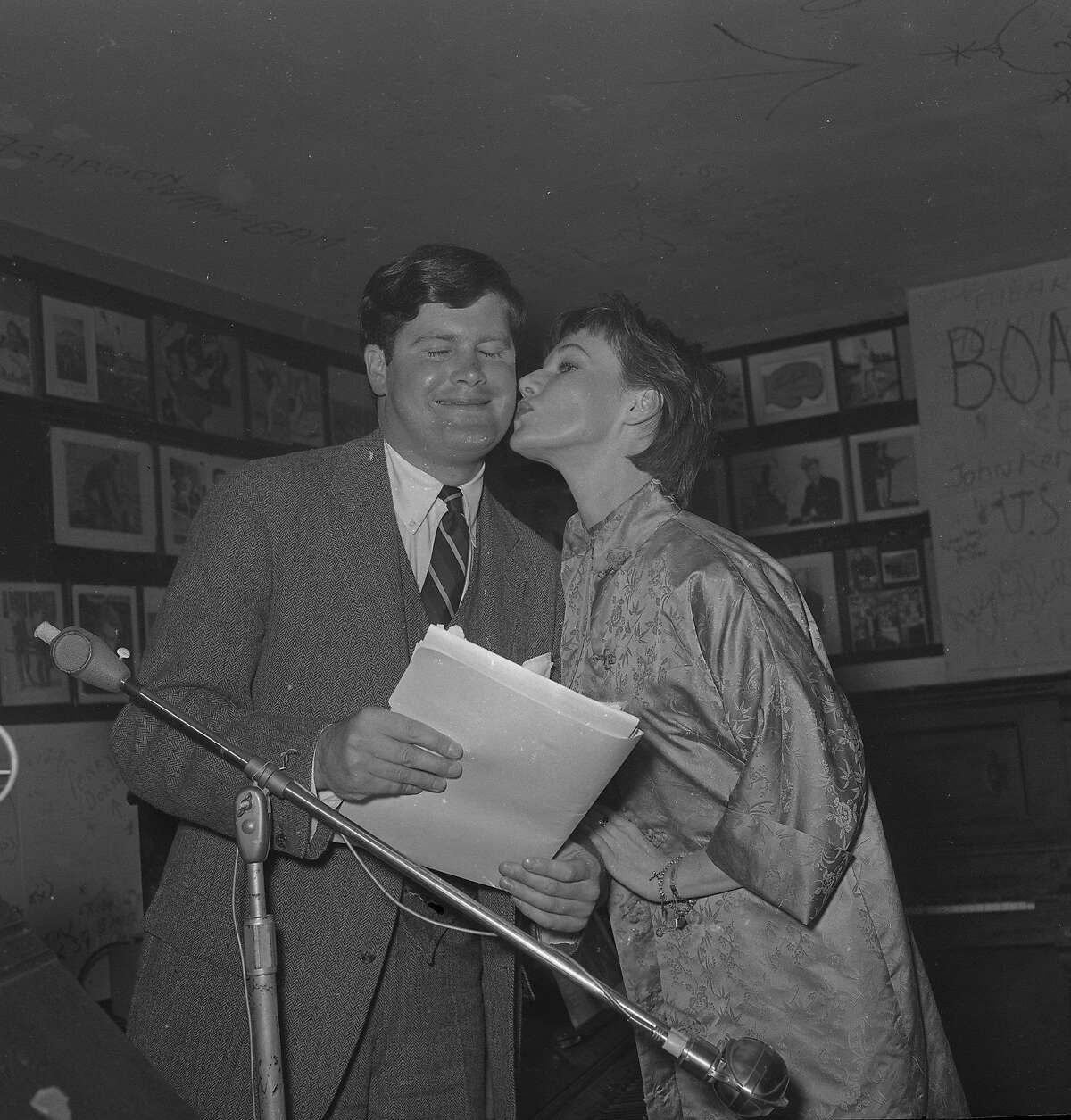 Warren Hinckle, kissed by Charlotte Fairchild, during his run for Supervisor Photo taken August 29, 1961