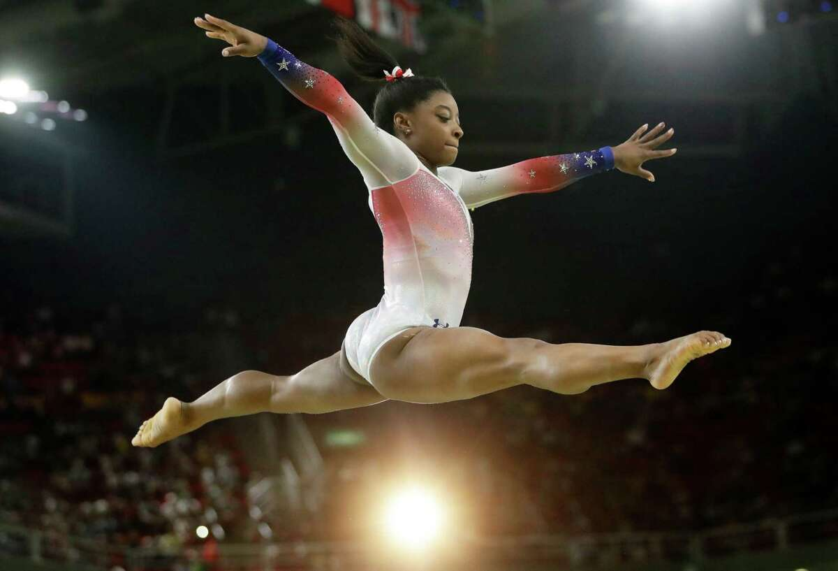 Spring's Simone Biles performs on the balance beam at the 2016 Summer Olympics in Rio de Janeiro, Brazil.