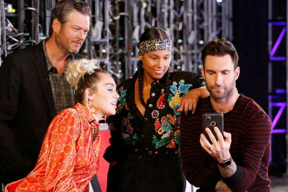 "With ""The Voice on Snapchat,"" coaches Blake Shelton, from left, Miley Cyrus, Alicia Keys and Adam Levine will judge user-submitted videos, with winners potentially appearing on the reality show's season premiere Sept. 19."