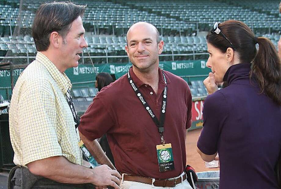 A's majority owner John Fisher, center, with his wife, Laura Fisher, and team General Manager Billy Beane. Photo: Ann Luke, Special To The Chronicle
