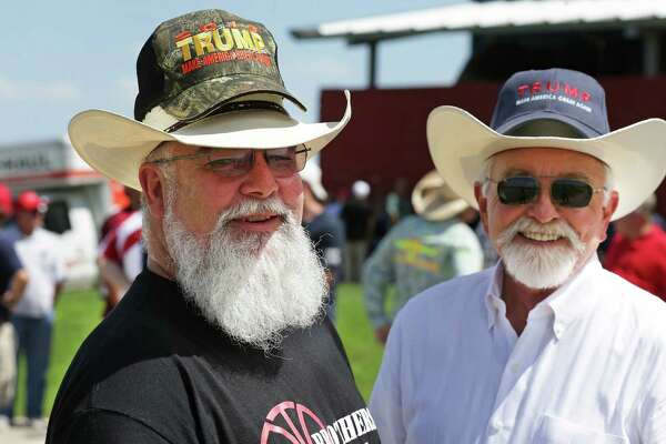 Steve Edmonson and Doc Borron (right) with Donald Trump supporters, arriving early in the day,  wait outside the gates of the Travis County Expo Center for the 7:30 p.m. rally of the Republican presidential candidate on August 23, 2016