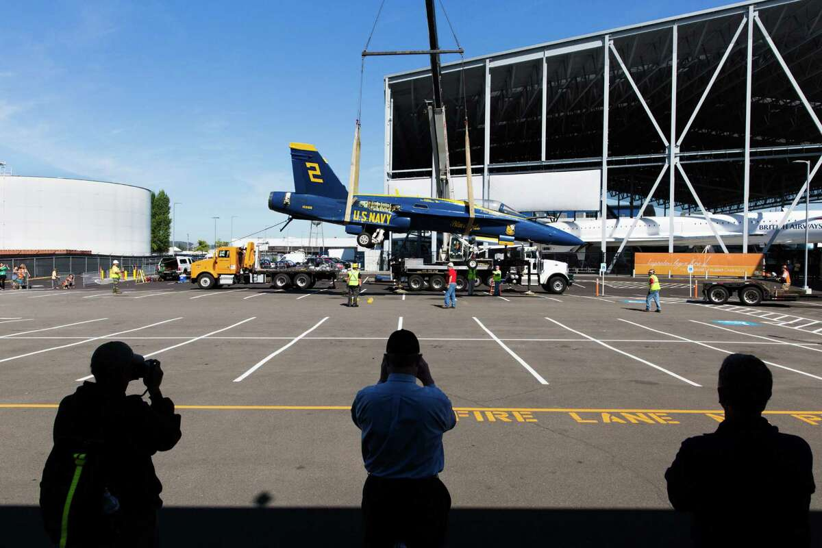 The Museum of Flight's new Blue Angel F/A-18C Hornet is lifted off a flat bed trailer after arrival at the pavilion on Tuesday, Aug. 23, 2016.
