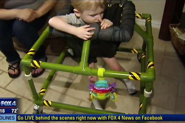 Silus Johnson, the 2-year-old who received a homemade custom walker, from workers at The Home Depot in Richland Hills, near Fort Worth.