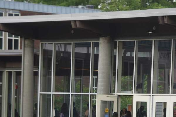 Students walk through the courtyard and in the front doors at Greenwich High School.