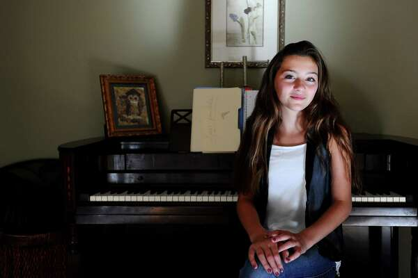"Lucy Scorziello, 12, who will be seventh-grader at Rippowam Middle School, will sing ""America the Beautiful"" next week at the U.S. Open tennis tournament in New York."