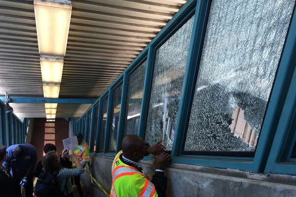 A man armed with a golf club was seen smashing windows at the West Oakland BART station. He also smashed the windows of a train, police said.