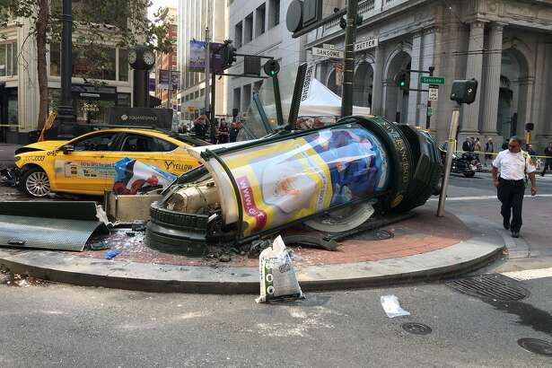 A taxi crashed into a newsstand and light pole near Market and Sutter streets in San Francisco on Tuesday, Aug. 23. Three people were in critical condition after the crash, according to the San Francisco Fire Department's Twitter feed.