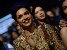 Bollywood actress Deepika Padukone is seen in the audience at the Mid Florida Credit Union Amphitheater during the IIFA Magic of the Movies show on the third day of the 15th International Indian Film Academy (IIFA) Awards in Tampa, Florida, April 25, 2014. AFP PHOTO JEWEL SAMAD (Photo credit should read JEWEL SAMAD/AFP/Getty Images)