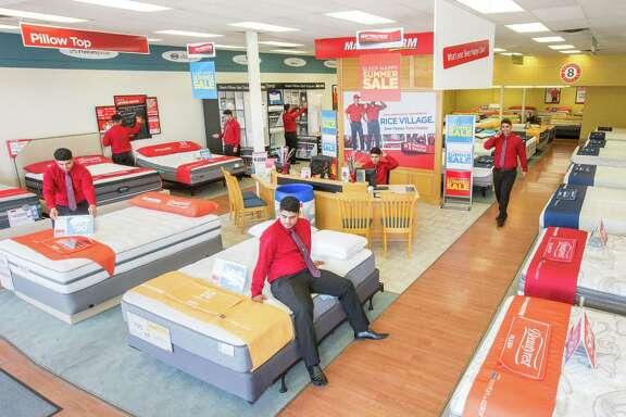 In this composite photo, Renan Brandao, a store manager for two Mattress Firm stores on Rice Boulevard, looks for things to do, Thursday, Aug. 11, 2016, in Houston.