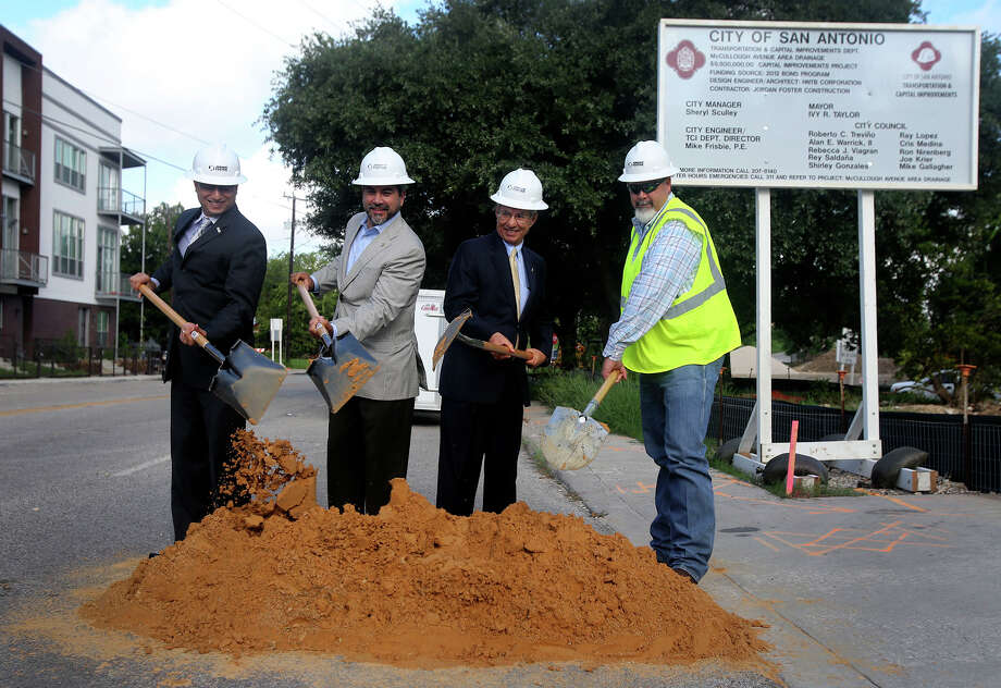 Antonio Rodriguez, (left) engineering project manager for the HNTB Corporation, District 1 city councilman Robert Trevino (left, center), Razi Hosseini (right, center), of the San Antonio Department of Transportation & Capital Improvements, and Clint Henson (right), operations manager at Jordan Foster Infrastructure take part in a groundbreaking ceremony Tuesday August 23, 2016 on the 100 block of Newell Avenue. The ceremony marks the start of the McCollough Avenue Area Drainage project, a $12.5 million endeavor aiming to reduce flooding in the downtown area including the lower level of Interstate Highway 35. The project is part of the City's 2012 bond program. Photo: John Davenport, Staff / San Antonio Express-News / ©San Antonio Express-News/John Davenport