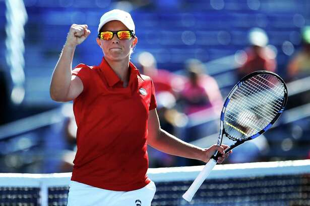 NEW HAVEN, CT - AUGUST 23:  Kirsten Flipkens of Belgium reacts after her victory over Belinda Bencic of Switzerland on day 3 of the Connecticut Open at the Connecticut Tennis Center at Yale on August 23, 2016 in New Haven, Connecticut.  (Photo by Adam Glanzman/Getty Images)