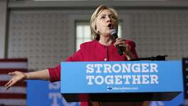 FILE - In this Aug. 16, 2016 file photo, Democratic presidential candidate Hillary Clinton speaks in Philadelphia. More than half the people outside the government who met with Hillary Clinton while she was secretary of state gave money, either personally or through companies or groups, to the Clinton Foundation. It's an extraordinary proportion indicating her possible ethics challenges if elected president.  (AP Photo/Carolyn Kaster, File)
