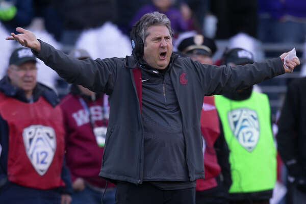 SEATTLE, WA - NOVEMBER 27: Washington State Cougars head coach Mike Leach protests a call during the first half of a football game against the Washington Huskies at Husky Stadium on November 27, 2015 in Seattle, Washington. (Photo by Stephen Brashear/Getty Images)