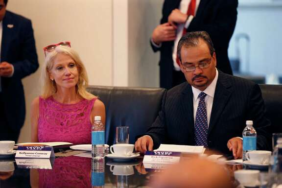 Kellyanne Conway, left, campaign manager for Republican presidential candidate Donald Trump, attends his Hispanic advisory roundtable meeting in New York, Saturday, Aug. 20, 2016. A right is Rick Figueroa, first vice president for FINC Firm of Houston. (AP Photo/Gerald Herbert)