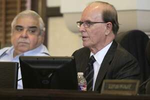 Bexar County commissioners Tuesday unanimously approved a $1.7 billion budget for the next fiscal year. County Judge Nelson Wolff and Commissioner Paul Elizondo are shown at a 2015 meeting.