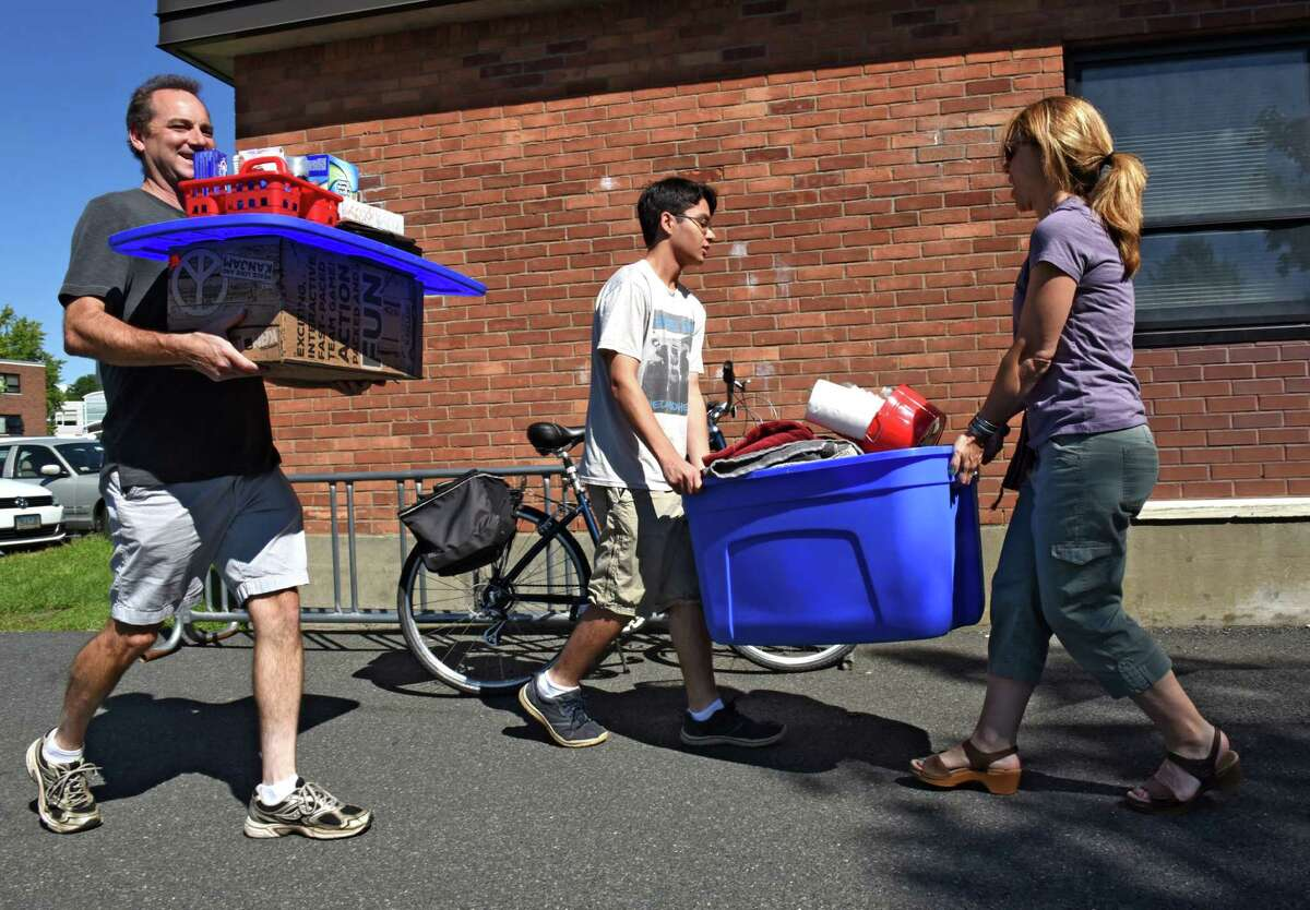 Freshman Surya Parasher of Wallkill, N.Y., center, gets help moving into his dorm from his parents Skip Luft and Jessica Filandgeri at Rensselaer Polytechnic Institute on Tuesday, Aug. 23, 2016 in Troy, N.Y. Many RPI students moved in today. (Lori Van Buren / Times Union)