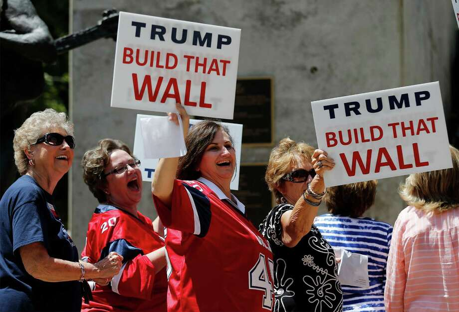 A group of women entering Moody Theater in Austin to take part in a town hall meeting with Republican Presidential candidate Donald Trump appear amused while holding signs toward demonstrators on Tuesday, Aug. 23, 2016. Demonstrators from the Texas Democratic Party along with other individuals chanted at Trump supporters as they filed their way into the theater. Along with the town hall meeting, Trump made an appearance for a fundraiser and rally in the Austin area. (Kin Man Hui/San Antonio Express-News) Photo: Kin Man Hui, Staff / San Antonio Express-News / ©2016 San Antonio Express-News