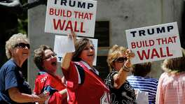 A group of women entering Moody Theater in Austin to take part in a town hall meeting with Republican Presidential candidate Donald Trump appear amused while holding signs toward demonstrators on Tuesday, Aug. 23, 2016. Demonstrators from the Texas Democratic Party along with other individuals chanted at Trump supporters as they filed their way into the theater. Along with the town hall meeting, Trump made an appearance for a fundraiser and rally in the Austin area. (Kin Man Hui/San Antonio Express-News)