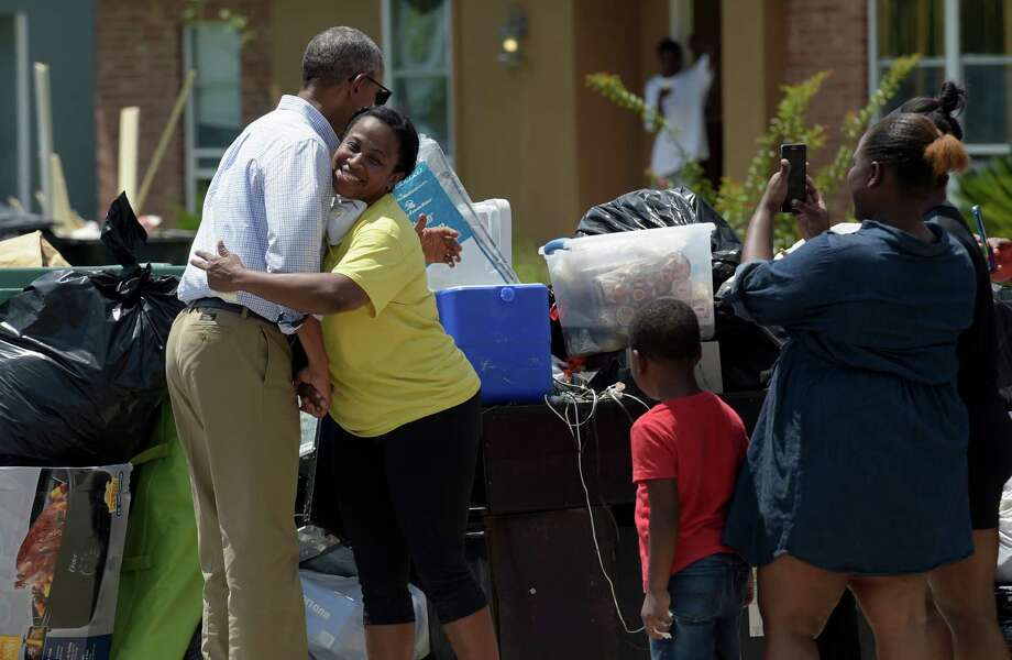 President Barack Obama hugs Marlette Sanders on Tuesday as he tours Castle Place, a flood-damaged neighborhood of Baton Rouge, La. Photo: Susan Walsh, STF / Copyright 2016 The Associated Press. All rights reserved. This material may not be published, broadcast, rewritten or redistribu