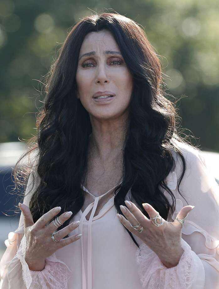 Singer and actress Cher stops to talk to media as she leaves a fundraiser for Democratic presidential candidate Hillary Clinton at the Pilgrim Monument and Provincetown Museum in Provincetown, Mass., Sunday, Aug. 21, 2016. (AP Photo/Carolyn Kaster) Photo: Carolyn Kaster, Associated Press