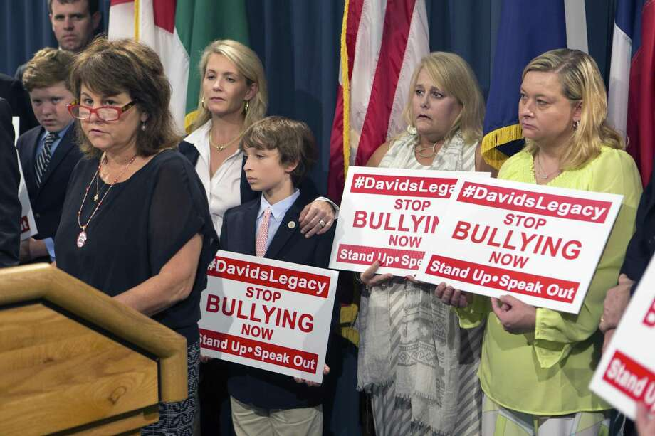 Maurine Molak speaks in August at a news conference at the Capitol about a bill being sponsored in her son David Molak's name. David Molak committed suicide after being cyberbullies by other teenagers. The bill was approved; starting Friday, it makes it a misdemeanor to electronically harass or bully a minor with the intent of causing them to harm themselves or commit suicide. Schools also must notify parents within one day if their child has been bullied or is accused of bullying others. Photo: William Luther /San Antonio Express-News / © 2016 San Antonio Express-News
