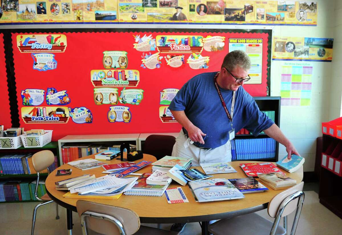 Fifth grade teacher Marc LaPierre prepares for the opening day of school at Mathewson School in Milford, Conn., on Tuesday Aug. 23, 2016. Kids come back to class on Aug. 29th.