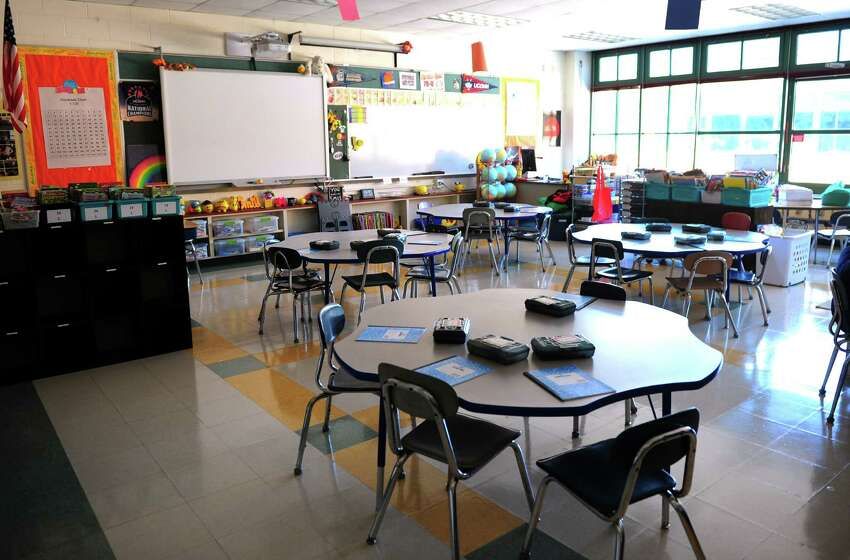 Teachers prepare for the opening day of school at Mathewson School in Milford, Conn., on Tuesday Aug. 23, 2016. Kids come back to class on Aug. 29th.