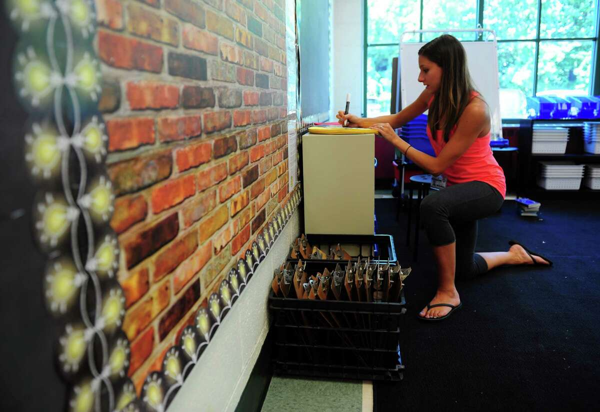 Fourth grade teacher Joelle Mauro prepares for the opening day of school at Mathewson School in Milford, Conn., on Tuesday Aug. 23, 2016. Kids come back to class on Aug. 29th.