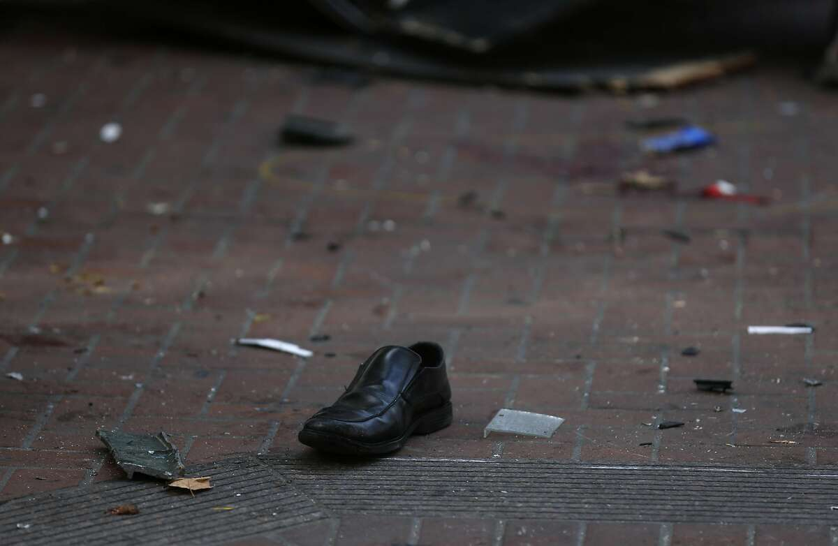A lone shoe lays on the ground at the scene of an accident involving a taxi that barreled into a newsstand, critically injuring three people including the driver on the corner of Sansome and Sutter streets in the Financial District August 23, 2016 in San Francisco, Calif.
