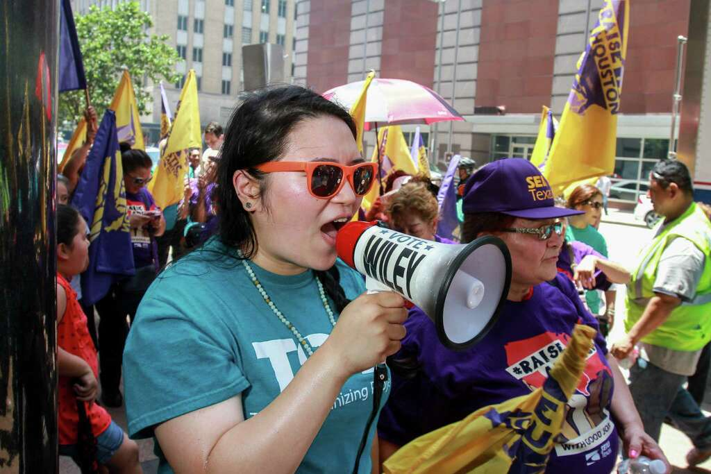 """Constance C. Luo, an immigration organizer with Texas Organizing Project, protest with janitors and members of Service Employees International Union Texas (SEIUTX) protest unfair treatment to janitors and commemorate """"Justice for Janitors Day"""" during protest in downtown Houston. (For the Chronicle/Gary Fountain, June 15, 2016) Photo: Gary Fountain, For The Chronicle / Copyright 2016 Gary Fountain"""
