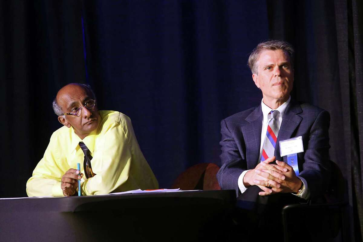 Health Collaborative board member Dr. Anil Mangla, left, and board chair Dr. Robert Ferrer present the 2016 Community Health Needs Assessment (CHNA), during their Community Shareholders Meeting at the Grantham Center, Tuesday, August 23, 2016.