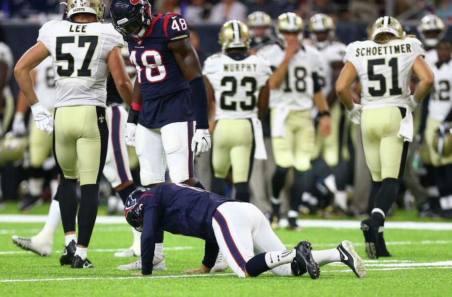 Houston Texans kicker Nick Novak (8) gets off the turf after trying to tackle New Orleans Saints running back Marcus Murphy (23) during the fourth quarter of an NFL game at NRG Stadium, Saturday, Aug. 20, {year}, in Houston. ( Karen Warren / Houston Chronicle ) Photo: Karen Warren, Staff Photographer / 2016 Houston Chronicle