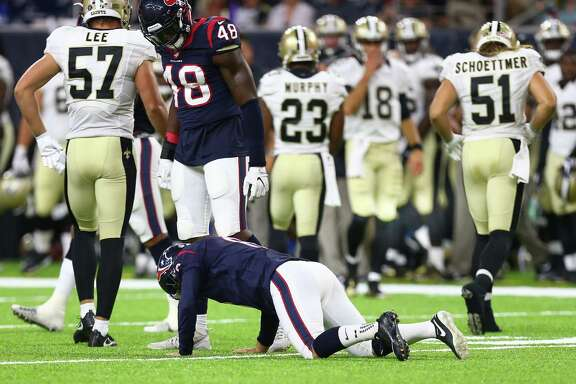 Houston Texans kicker Nick Novak (8) gets off the turf after trying to tackle New Orleans Saints running back Marcus Murphy (23) during the fourth quarter of an NFL game at NRG Stadium, Saturday, Aug. 20, {year}, in Houston. ( Karen Warren / Houston Chronicle )