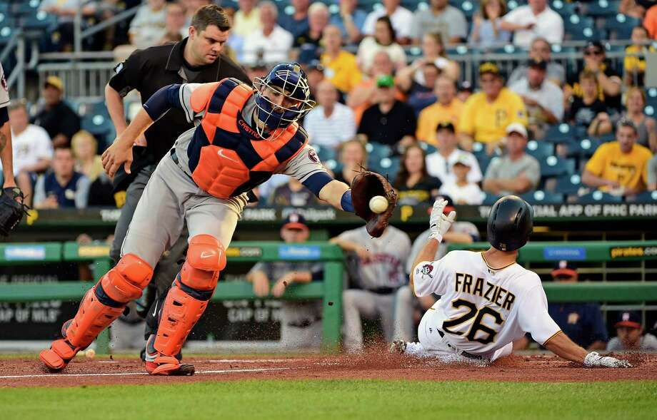 Adam Frazier beats the throw to Astros catcher Jason Castro to score the first of the Pirates' four runs in the first inning Tuesday night. Photo: Fred Vuich, FRE / Fred Vuich
