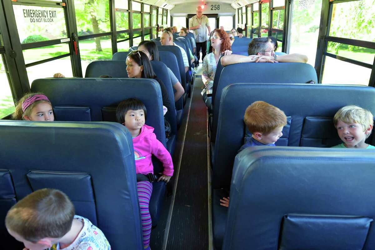 Children sit up front as their parents sit in the back of a school bus during a ride at a bus safety event for parents and children entering kindergarten at the Rosendale Elementary School on Tuesday, Aug. 23, 2016, in Niskayuna, N.Y. (Paul Buckowski / Times Union)