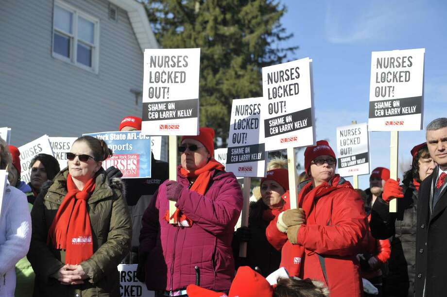 Nurse from Nathan Littauer Hospital along with members of various other unions hold a picket outside the hospital on Thursday, Jan. 7, 2016, in Gloversville, N.Y.  The nurses at the hospital were locked out of hospital, following one-day strike.  (Paul Buckowski / Times Union) Photo: PAUL BUCKOWSKI / 10034907A