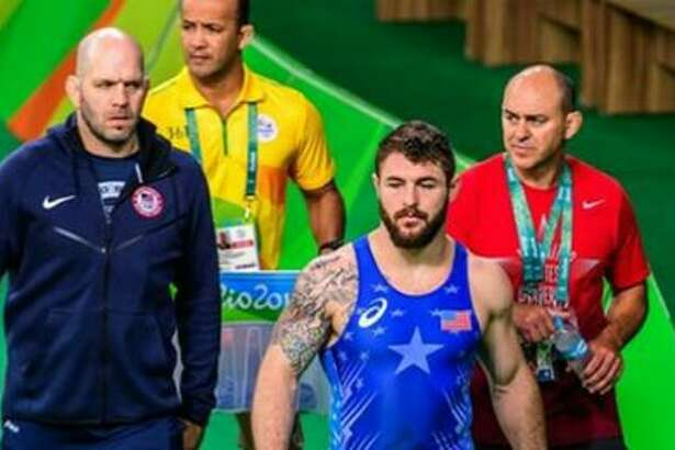 Chris Saba, right, walks out for a match in the Rio Olympics with wrestler Ben Proviser, middle, and Team USA coach Matt Lindland, left. (Photo courtesy Chris Saba)