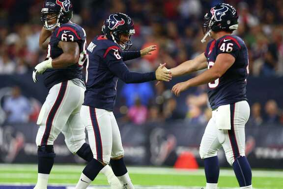 Houston Texans kicker Nick Novak (8) celebrates his field goal with Jon Weeks (46) during the second quarter of an NFL game at NRG Stadium, Saturday, Aug. 20, {year}, in Houston. ( Karen Warren / Houston Chronicle )