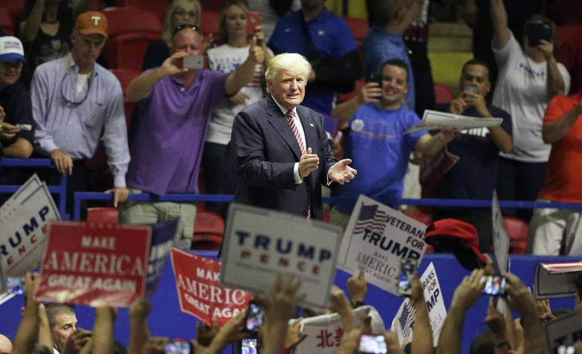 Donald Trump exits to applause at the Travis County Expo Center for a rally on Aug. 23. His candidacy was successful because of a deep vein of populism he mined.