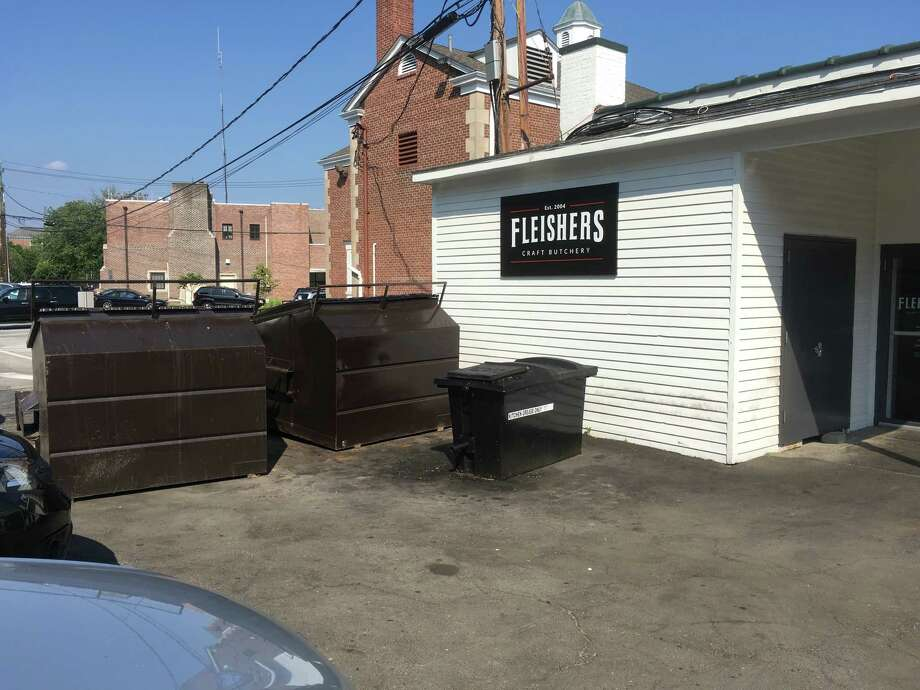A landlord's plan to move these dumpsters has met with resistance from neighbors and the P&Z. Photo: Contributed Photo